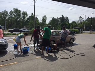 Volunteers hold a free car wash at the Big Give 2016.