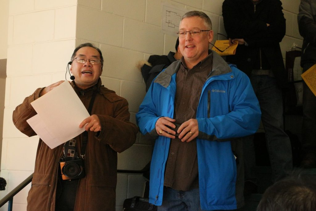 Pastors Jack Xie and Darren Milley stand together at a joint thanksgiving and building-renaming ceremony.