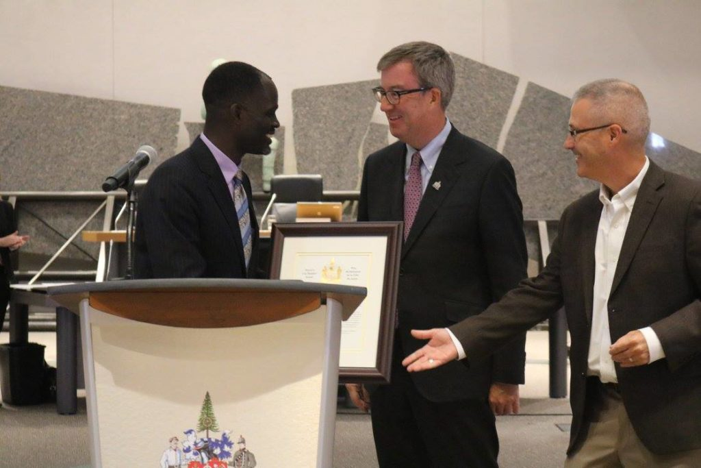 Joseph Kiirya receives the City Builder Award.