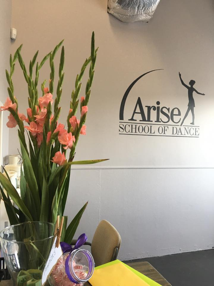 The sign inside Arise School of Dance.