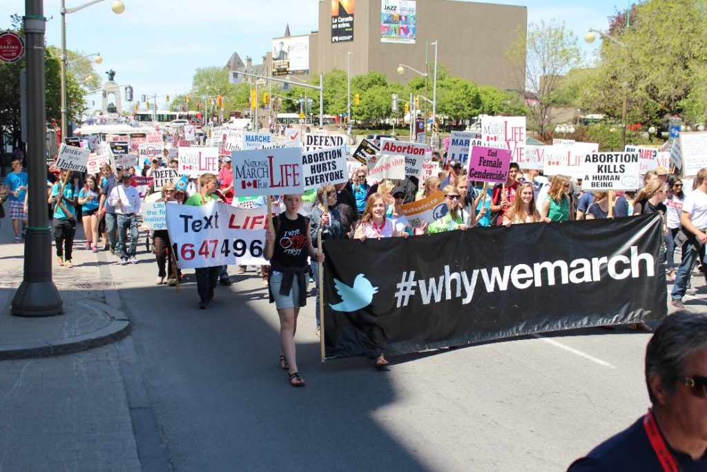 Protesters march through Ottawa streets.