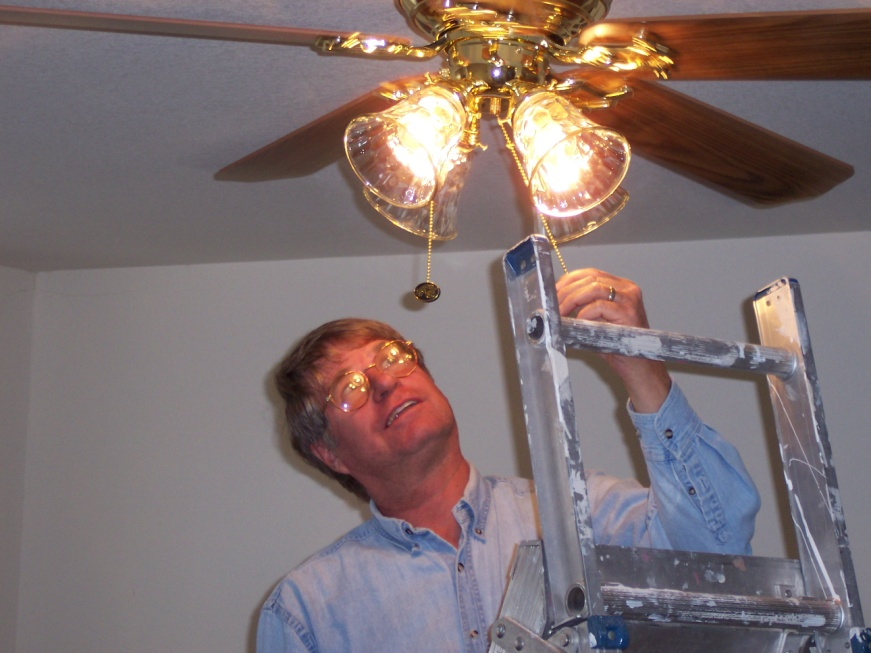 A man fixes a light.
