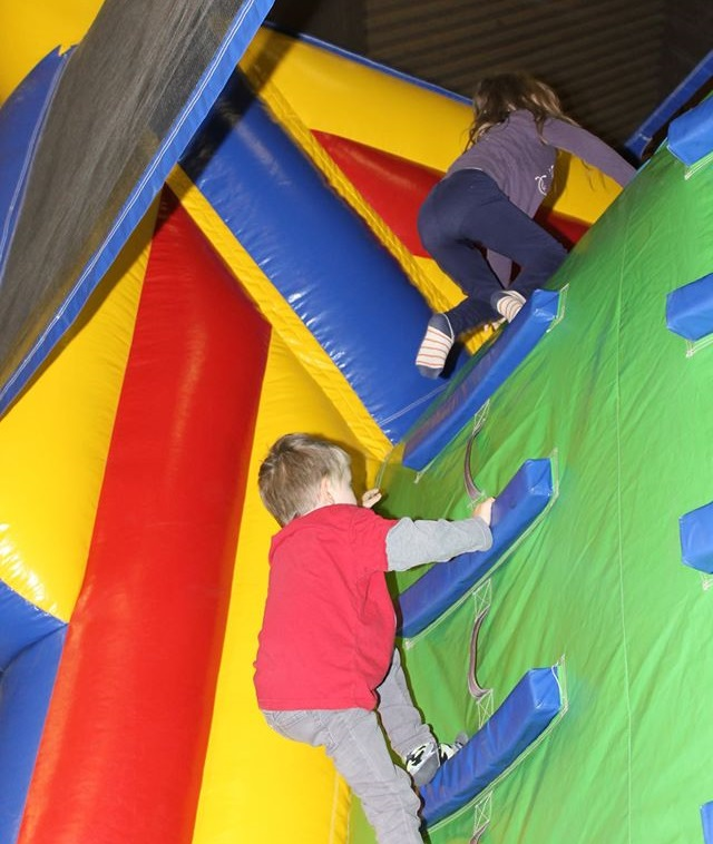 Kids climb and inflatable slide.