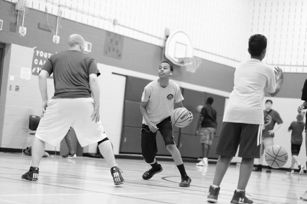 Youth play basketball.