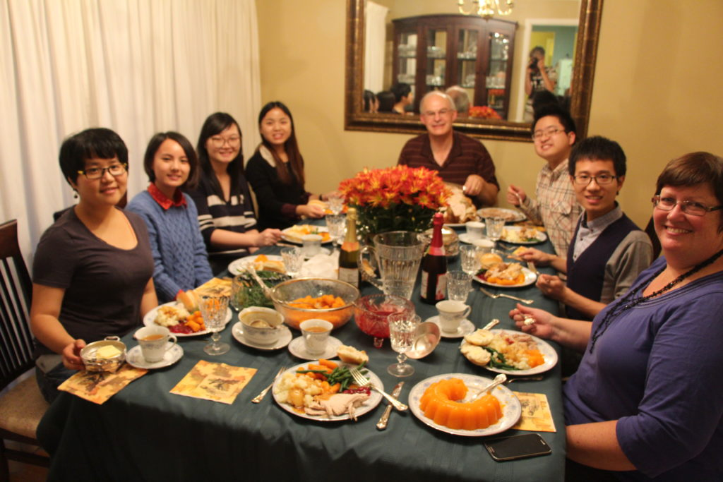 International students share a Christmas dinner with a Canadian family.